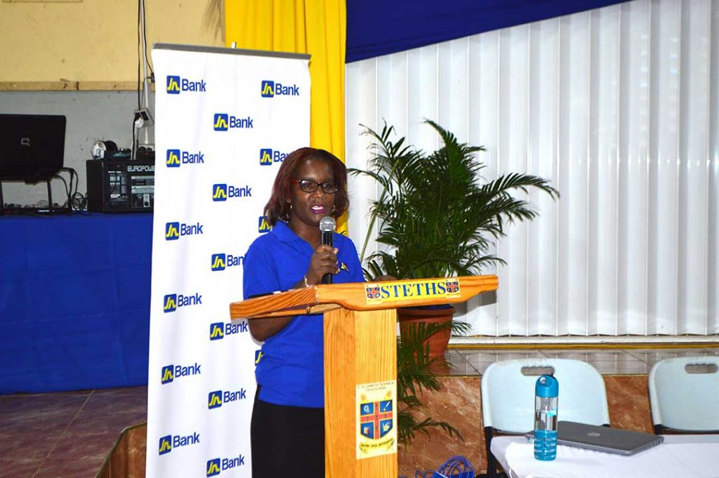 Business Relationship and Sales Manager for JN Bank, Lorna Sinclair presents to seasonal agricultural workers, also known as farm workers during a financial literacy programme at the St. Elizabeth High School on April 10.