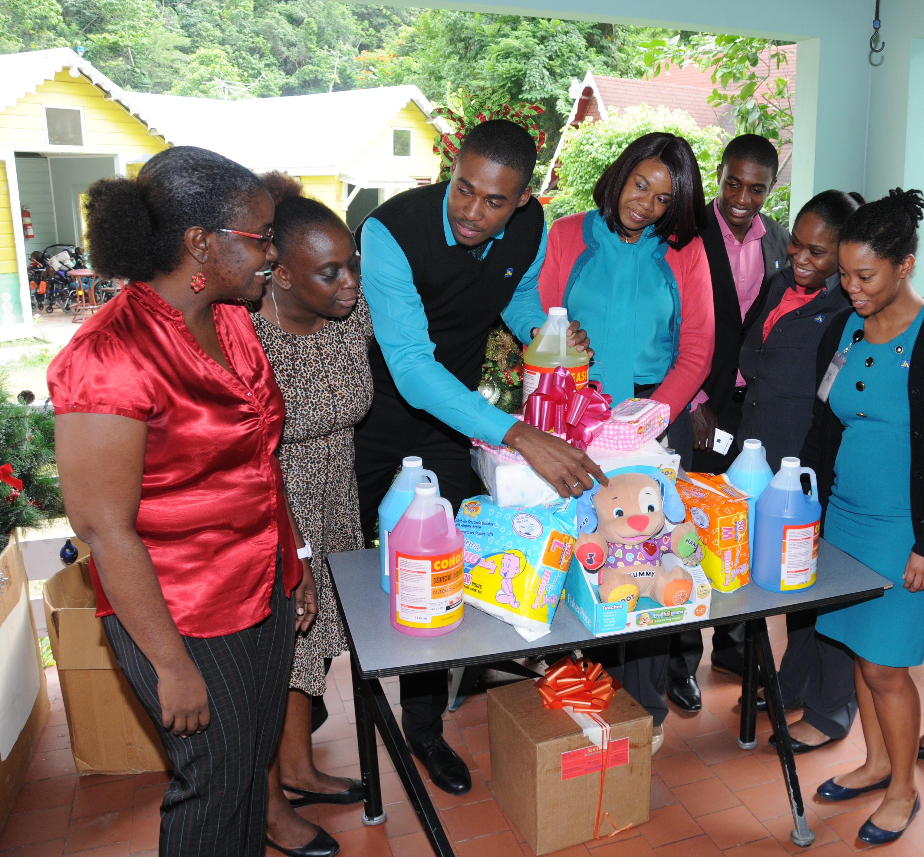 Opal Bailey (left), Childcare Manager of Sophie's Place and Christine Watson (second left), Matron, Sophie's Place; are delighted to receive donation of supplies from employees of The Jamaica National Group, who have for the past 10 years have been helping to sponsor the cost of medication for the children of the home every month.