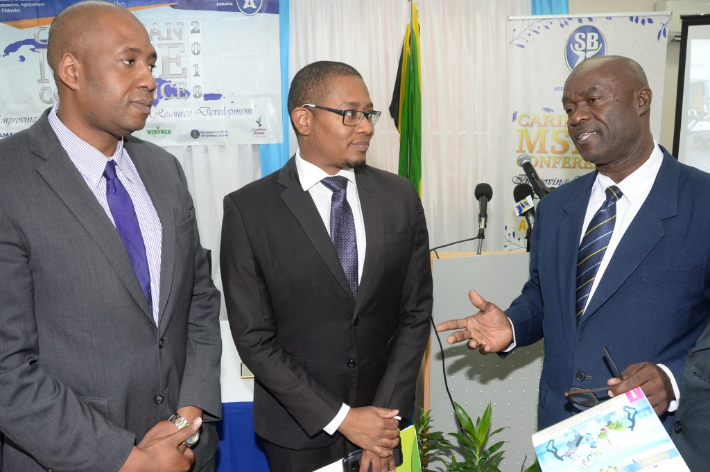 Hugh Johnson (right), president of the Small Business Association of Jamaica, makes a point to Ryan Parkes, chief of business banking at JN Bank and Floyd Green, minister of state in the Ministry of Industry, Commerce, Agriculture and Fisheries during the launch of the MSME Conference 2019 last Wednesday at the ministry's office in New Kingston.